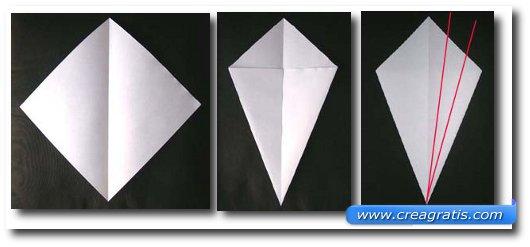 Seconda immagine con le istruzioni per fare un cigno di carta